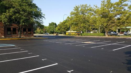 Commercial parking area with Parking lot striping and directional signage