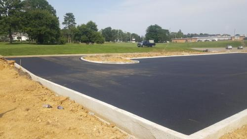 Another view of  paved commercial parking area